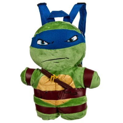 Get a shell of a partner with a Leonardo Plush Backpack! This cool turtle backpack features a soft plush design of Leonardo complete with moveable arms and legs. A zipper on the top opens up to a secure pocket that's great for storing small valuables. With adjustable blue straps this Teenage Mutant Ninja Turtles backpack is perfect to take with you anywhere! Leonardo Plush Backpack product details:  Measures 11in x 13 1-2in x 4in Pocket measures 9in x 7 1-2in Plush  Adjustable straps