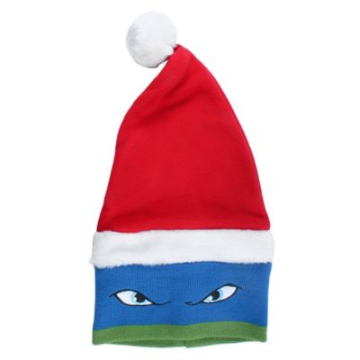 The half-shells are in the holiday spirit with this Teenage Mutant Ninja Turtles Child Christmas Leonardo Beanie! This TMNT hat features Leonardo's eyes peering through his signature blue mask & he's even wearing a fleece Santa hat! Add it to stockings or wrap it up to give to your little ninja on Christmas morning. Teenage Mutant Ninja Turtles Child Christmas Leonardo Beanie product details:  8 1-2in wide x 17in tall when flat  100% acrylic One size fits most children Hand wash cold dry flat  Officially licensed ©Nickelodeon Teenage Mutant Ninja Turtles™ product.