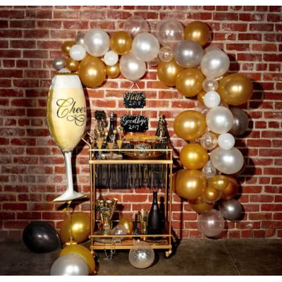 To view assembly instructions CLICK HERE. Give your party an instant wow-factor with the Air-Filled Bubbly Balloon Garland Kit! This kit includes everything you need to make a beautiful balloon garland  no helium required. Use this kit to create backdrops centerpieces and entryway displays that last for 2-3 days. Whether for birthdays or New Year's celebrations this balloon decoration will be a stunning addition to your party decor. Do not use helium. Instructions not included with package. For instructions on how to assemble please see below or refer to the 'Instructions' image on this page. This kit includes:  50 Mini White Balloons (SKU 186066) 1 Champagne Glass Balloon (SKU 47088) 72 Clear Balloons (SKU 478413) 20 Black Balloons (SKU 632412) 20 Gold Pearl Balloons (SKU 632423) 20 Silver Pearl Balloons (SKU 632424) 50 Clear Mini Balloons (SKU 632451) 50 Gold Pearl Mini Balloons (SKU 632461) 50 Silver Pearl Mini Balloons (SKU 632462) 20 White Balloons (SKU 71071) 1 Balloon Arch Decorating Strip (SKU 862880)  Additional recommended supplies (sold separately):  Air pump (electric or hand-held) Double-sided tape or Scotch tape Scissors  To Assemble:  Inflate all balloons with air and tie a knot at the end. (Balloon pump not included. Recommended for quick inflation.) Insert balloon lips into decorating strip holes and gently pull balloon knots through the holes to secure. Alternate balloon sizes (9-inch 12-inch and 24-inch) and skip holes as needed on decorating strip as you attach balloons. Tie a long piece of curling ribbon to an empty hole at each end of the decorating strip and hang garland against a wall or from the ceiling. Apply tape to 5-inch balloons and fill in gaps on balloon garland.  Decorating Tip: Enhance balloon garlands by adding balloon tassels flowers foliage swirl decorations and tassel garlands to balloons using tape! Accessories sold separately.