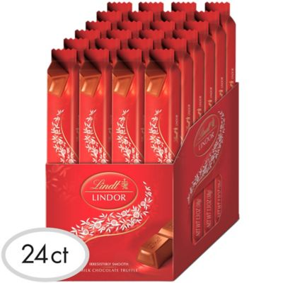 Get your favorite chocolate bar in bulk with this box of Lindor Milk Chocolate Truffle Bars! Irresistibly smooth milk chocolate makes a perfect gift for family and friends. Use this large box of Lindor chocolate to stuff favor bags or stockings & just don't forget to save a few bars for yourself! Lindor Milk Chocolate Truffle Bars product details:  24 per package Individually wrapped 1.34oz individual net weight 32.2oz package net weight Contains milk and soy May contain peanuts and tree nuts
