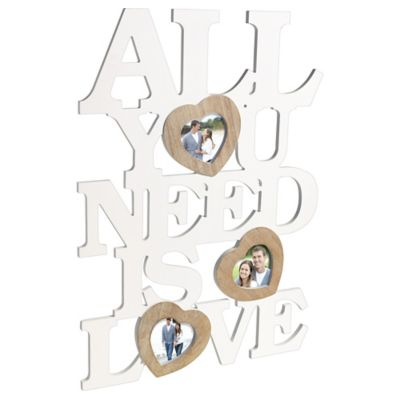 Show off you and your sweetheart's unbreakable bond with a All You Need Is Love Photo Frame 4ct! This large fiberboard photo frame features white letter cutouts that spell out All You Need Is Love. The photo frame also features attached heart frames for you to insert pictures in. Guests will be feeling the love in the air when you decorate your home with this photo frame! All You Need Is Love Photo Frame 4ct product details:  15in wide x 23in tall MDF (Medium Density Fiberboard) and plastic Attached loop 5in drop length Fits 3 4in x 4in photos