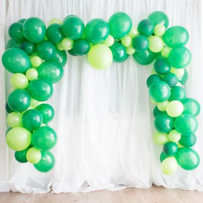 To view assembly instructions CLICK HERE. Give your party an instant wow-factor with this Festive Green & Kiwi Balloon Garland Kit! The kit includes everything you need to make a beautiful balloon garlandno helium required. Use this kit to make backdrops centerpieces and jaw-dropping entryways that last for 2-3 days! Whether for birthdays baby showers or holiday parties this balloon decoration will be a stunning focal point at your next celebration. Do not use helium. Instructions not included with package! For instructions on how to assemble please see below or refer to the 'Instructions' image on this page. This kit includes:  45 Festive Green Balloons (SKU 243630) 30 Kiwi Green Pearl Balloons (SKU 632402) 50 Kiwi Green Mini Balloons (SKU 632453) 1 Kiwi Green Curling Ribbon (SKU 474070) 1 Balloon Arch Decorating Strip 25ft (SKU 862880)  Additional recommended supplies (sold separately):  Air pump (electric or hand-held) Double-sided tape or Scotch tape Scissors  To Assemble:  Inflate all balloons with air and tie a knot at the end. (Balloon pump not included. Recommended for quick inflation.) Insert balloon lips into decorating strip holes and gently pull balloon knots through the holes to secure. Alternate balloon sizes (9-inch 12-inch and 24-inch) and skip holes as needed on decorating strip as you attach balloons. Tie a long piece of curling ribbon to an empty hole at each end of the decorating strip and hang garland against a wall or from the ceiling. Apply tape to 5-inch balloons and fill in gaps on balloon garland.  Decorating Tip: Enhance balloon garlands by adding balloon tassels flowers foliage swirl decorations and tassel garlands to balloons using tape! Accessories sold separately.