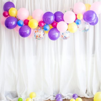 To view assembly instructions CLICK HERE. Give your party an instant wow-factor with this Rainbow Confetti Balloon Garland Kit! The kit includes everything you need to make a beautiful balloon garlandno helium required. Use this kit to make backdrops centerpieces and jaw-dropping entryways that last for 2-3 days! Whether for birthdays baby showers or holiday parties this balloon decoration will be a stunning focal point at your next celebration. Do not use helium. Instructions not included with package! For instructions on how to assemble please see below or refer to the 'Instructions' image on this page. This kit includes:  15 Purple Pearl Balloons (SKU 632405) 15 Pink Pearl Balloons 15ct (SKU 632404) 50 Assorted Color Mini Balloons (SKU 632446) 6 Multicolor Confetti Balloons (SKU 811630) 40 Sunshine Yellow Balloons (SKU 71073) 1 White Curling Ribbon Keg (SKU 789021) 1 Balloon Arch Decorating Strip 25ft (SKU 862880)  Additional recommended supplies (sold separately):  Air pump (electric or hand-held) Double-sided tape or Scotch tape Scissors  To Assemble:  Inflate all balloons with air and tie a knot at the end. (Balloon pump not included. Recommended for quick inflation.) Insert balloon lips into decorating strip holes and gently pull balloon knots through the holes to secure. Alternate balloon sizes (9-inch 12-inch and 24-inch) and skip holes as needed on decorating strip as you attach balloons. Tie a long piece of curling ribbon to an empty hole at each end of the decorating strip and hang garland against a wall or from the ceiling. Apply tape to 5-inch balloons and fill in gaps on balloon garland.  Decorating Tip: Enhance balloon garlands by adding balloon tassels flowers foliage swirl decorations and tassel garlands to balloons using tape! Accessories sold separately.