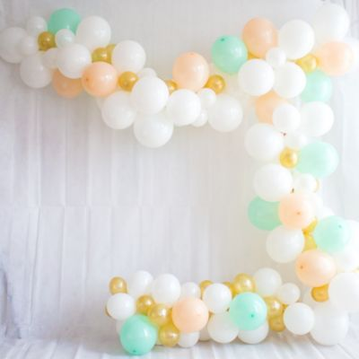 To view assembly instructions CLICK HERE. Give your party an instant wow-factor with this Pastel Balloon Garland Kit! The kit includes everything you need to make a beautiful balloon garlandno helium required. Use this kit to make backdrops centerpieces and jaw-dropping entryways that last for 2-3 days! Whether for birthdays baby showers or holiday parties this balloon decoration will be a stunning focal point at your next celebration. Do not use helium. Instructions not included with package! For instructions on how to assemble please see below or refer to the 'Instructions' image on this page. This kit includes:  30 White Pearl Balloons (SKU 632411) 15 Rose Gold Pearl Balloons (SKU 800669) 15 Robin's Egg Blue Pearl Balloons (SKU 632408) 50 Gold Pearl Mini Balloons (SKU 632461) 1 White Curling Ribbon Keg (SKU 789021) 1 Balloon Arch Decorating Strip 25ft (SKU 862880)  Additional recommended supplies (sold separately):  Air pump (electric or hand-held) Double-sided tape or Scotch tape Scissors  To Assemble:  Inflate all balloons with air and tie a knot at the end. (Balloon pump not included. Recommended for quick inflation.) Insert balloon lips into decorating strip holes and gently pull balloon knots through the holes to secure. Alternate balloon sizes (9-inch 12-inch and 24-inch) and skip holes as needed on decorating strip as you attach balloons. Tie a long piece of curling ribbon to an empty hole at each end of the decorating strip and hang garland against a wall or from the ceiling. Apply tape to 5-inch balloons and fill in gaps on balloon garland.  Decorating Tip: Enhance balloon garlands by adding balloon tassels flowers foliage swirl decorations and tassel garlands to balloons using tape! Accessories sold separately.