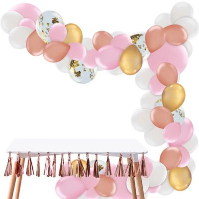 To view assembly instructions CLICK HERE. Give your party an instant wow-factor with this Gold & Pink Balloon Garland Kit! The kit includes everything you need to make a beautiful balloon garlandno helium required. Use this kit to make backdrops centerpieces and jaw-dropping entryways that last for 2-3 days! Whether for birthdays baby showers or holiday parties this balloon decoration will be a stunning focal point at your next celebration. Do not use helium. Instructions not included with package! For instructions on how to assemble please see below or refer to the 'Instructions' image on this page. This kit includes:  25 Gold Chrome Balloons (SKU 830610) 15 Pink Pearl Balloons (SKU 632404) 4 Pink Balloons (SKU 632436) 20 White Balloons (SKU 71071) 5 Ginger Ray Gold Confetti Balloons (SKU 830599) 50 Pink Mini Balloons (SKU 632455) 20 Rose Gold Pearl Balloons (SKU 800671) 1 White Curling Ribbon Keg (SKU 789021) 1 Balloon Arch Decorating Strip 25ft (SKU 862880)  Additional recommended supplies (sold separately):  Air pump (electric or hand-held) Double-sided tape or Scotch tape Scissors  To Assemble:  Inflate all balloons with air and tie a knot at the end. (Balloon pump not included. Recommended for quick inflation.) Insert balloon lips into decorating strip holes and gently pull balloon knots through the holes to secure. Alternate balloon sizes (9-inch 12-inch and 24-inch) and skip holes as needed on decorating strip as you attach balloons. Tie a long piece of curling ribbon to an empty hole at each end of the decorating strip and hang garland against a wall or from the ceiling. Apply tape to 5-inch balloons and fill in gaps on balloon garland.  Decorating Tip: Enhance balloon garlands by adding balloon tassels flowers foliage swirl decorations and tassel garlands to balloons using tape! Accessories sold separately.