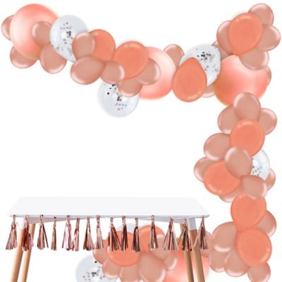 To view assembly instructions CLICK HERE. Give your party an instant wow-factor with this Rose Gold Balloon Garland Kit! The kit includes everything you need to make a beautiful balloon garlandno helium required. Use this kit to make backdrops centerpieces and jaw-dropping entryways that last for 2-3 days! Whether for birthdays baby showers or holiday parties this balloon decoration will be a stunning focal point at your next celebration. Do not use helium. Instructions not included with package! For instructions on how to assemble please see below or refer to the 'Instructions' image on this page. This kit includes:  72 Rose Gold Pearl Balloons (SKU 810528) 20 Rose Gold Pearl Balloons (SKU 800671) 4 Rose Gold Pearl Balloons (SKU 800670) 10 Ginger Ray Rose Gold Confetti Balloons (SKU 830601) 50 Rose Gold Pearl Mini Balloons (SKU 800668) 1 White Curling Ribbon Keg (SKU 789021) 1 Balloon Arch Decorating Strip 25ft (SKU 862880)  Additional recommended supplies (sold separately):  Air pump (electric or hand-held) Double-sided tape or Scotch tape Scissors  To Assemble:  Inflate all balloons with air and tie a knot at the end. (Balloon pump not included. Recommended for quick inflation.) Insert balloon lips into decorating strip holes and gently pull balloon knots through the holes to secure. Alternate balloon sizes (9-inch 12-inch and 24-inch) and skip holes as needed on decorating strip as you attach balloons. Tie a long piece of curling ribbon to an empty hole at each end of the decorating strip and hang garland against a wall or from the ceiling. Apply tape to 5-inch balloons and fill in gaps on balloon garland.  Decorating Tip: Enhance balloon garlands by adding balloon tassels flowers foliage swirl decorations and tassel garlands to balloons using tape! Accessories sold separately.