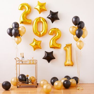 Create the ultimate New Year's Eve party decoration with the Air-Filled Black & Gold New Year's Eve Balloon Kit! This kit includes everything you need to create a festive backdrop for a New Year's celebration. Simply inflate balloons with air and attach them to a wall. Enjoy this helium free balloon decoration for 2-3 days. Do not use helium. Instructions not included with package. For instructions on how to assemble please see below. This kit includes:  15 Black Pearl Balloons (SKU 632396) 15 Gold Pearl Balloons (SKU 632401) 3 Gold Curling Ribbon (SKU 474074) 2 Gold Star Balloon (SKU 45005) 2 Black Star Balloon (SKU 60619) 2 34in Gold Number Balloon (2) (SKU 552240) 2 34in Gold Number Balloon (0) (SKU 552238)  Additional recommended supplies (sold separately):  Air pump (electric or hand-held) Double-sided tape or Scotch tape  To Assemble:  Inflate all balloons with air and tie a knot at the end. (Balloon pump not included. Recommended for quick inflation.) Attach balloons to wall using tape or hang using curling ribbon.  Balloon Tip: Electric balloon pumps make inflation quicker; helium is not required.