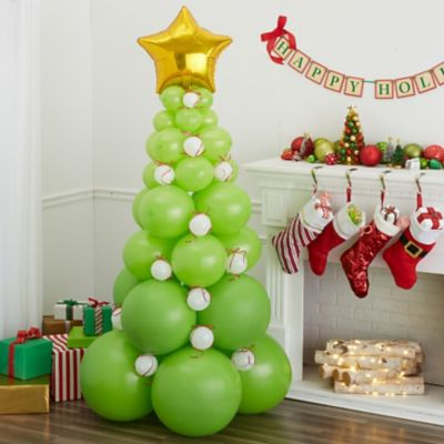 To view assembly instructions CLICK HERE. Deck the halls and create holiday cheer with the Green Balloon Christmas Tree Kit! This kit includes everything you need to make a festive Christmas balloon decorationno helium required. Perfect for homes event spaces and offices this balloon kit makes decorating for the holidays easy and lasts for 2-3 days! Bring on the wow-factor at your next holiday celebration with the Green Balloon Christmas Tree Kit. Do not use helium. For instructions on how to assemble please see below or refer to the 'Instructions' image on this page. This kit includes:  8 Kiwi Green Balloons (SKU 632434) 15 Kiwi Green Pearl Balloons (SKU 632402) 20 Kiwi Green Balloons (SKU 632417) 50 Kiwi Green Mini Balloons (SKU 632453) 50 Mini White Balloons (SKU 186066) 1 Prismatic Red Curling Ribbon (SKU 48153) 1 White Curling Ribbon (SKU 70174) 1 Gold Star Balloon (SKU 45005)  Additional recommended supplies (sold separately):  Air pump (electric or hand-held) Balloon Glue Dots Double-sided tape or Scotch tape Scissors  To Assemble:  Inflate all balloons with air and tie a knot at the end. (Balloon pump not included. Recommended for quick inflation. Tie two 24-inch balloons together with the lip of the balloons; repeat until you have 4 sets of 2 balloons. Lay one set of balloons on the floor and lay another set on top so the balloons form an X. Using curling ribbon tie the four balloons together in the center. Repeat steps 3-4 for the remaining 2 sets of balloons. You will now have 2 sets of 4 balloons. Stack one set of balloons on top of the other and tie both tiers together using curling ribbon. Repeat steps 2-6 with 8 12-inch balloons 8 9-inch balloons and 8 5-inch balloons. For step 6 stack balloons from largest to smallest at the top. (You will have 8 tiers total 2 tiers of each size) Tie the star to the top tier using curling ribbon. Cut 24 pieces of ribbon and tie in a bow. Place bows on remaining ornament balloons with tape or glue dots. Fill in the ho