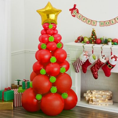 To view assembly instructions CLICK HERE. Deck the halls and create holiday cheer with the Red Balloon Christmas Tree Kit! This kit includes everything you need to make a festive Christmas balloon decorationno helium required. Perfect for homes event spaces and offices this balloon kit makes decorating for the holidays easy and lasts for 2-3 days! Bring on the wow-factor at your next holiday celebration with the Red Balloon Christmas Tree Kit. Do not use helium. For instructions on how to assemble please see below or refer to the 'Instructions' image on this page. This kit includes:  8 Red Balloons (SKU 632426) 15 Red Pearl Balloons (SKU 632394) 20 Red Balloons (SKU 71066) 50 Red Mini Balloons (SKU 632445) 50 Kiwi Green Mini Balloons (SKU 632453) 1 Metallic Gold Curling Ribbon (SKU 789029) 1 White Curling Ribbon (SKU 70174) 1 Gold Star Balloon (SKU 45005)  Additional recommended supplies (sold separately):  Air pump (electric or hand-held) Balloon Glue Dots Double-sided tape or Scotch tape Scissors  To Assemble:  Inflate all balloons with air and tie a knot at the end. (Balloon pump not included. Recommended for quick inflation. Tie two 24-inch balloons together with the lip of the balloons; repeat until you have 4 sets of 2 balloons. Lay one set of balloons on the floor and lay another set on top so the balloons form an X. Using curling ribbon tie the four balloons together in the center. Repeat steps 3-4 for the remaining 2 sets of balloons. You will now have 2 sets of 4 balloons. Stack one set of balloons on top of the other and tie both tiers together using curling ribbon. Repeat steps 2-6 with 8 12-inch balloons 8 9-inch balloons and 8 5-inch balloons. For step 6 stack balloons from largest to smallest at the top. (You will have 8 tiers total 2 tiers of each size) Tie the star to the top tier using curling ribbon. Cut 24 pieces of ribbon and tie in a bow. Place bows on remaining ornament balloons with tape or glue dots. Fill in the holes on your tree by taping 